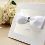 white-bow-wedding-invitation