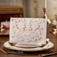 Opulent-white-lasercut-pocket-wedding-invitation