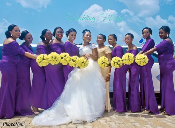 bridesmaids in purple with yellow bouquets